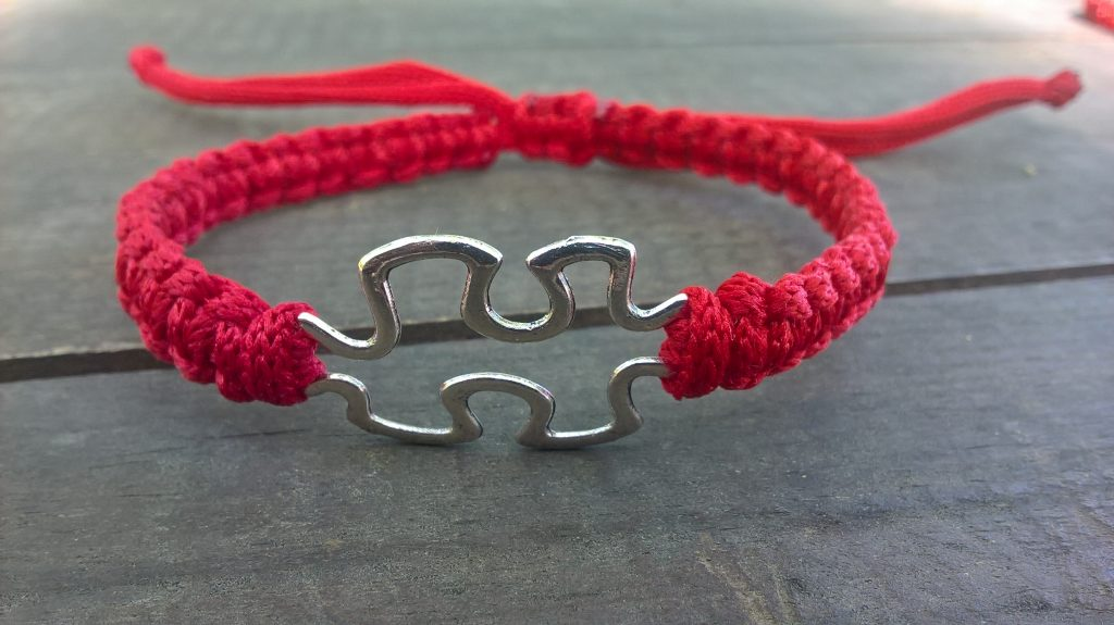 Handmade red puzzle friendship, macrame bracelet