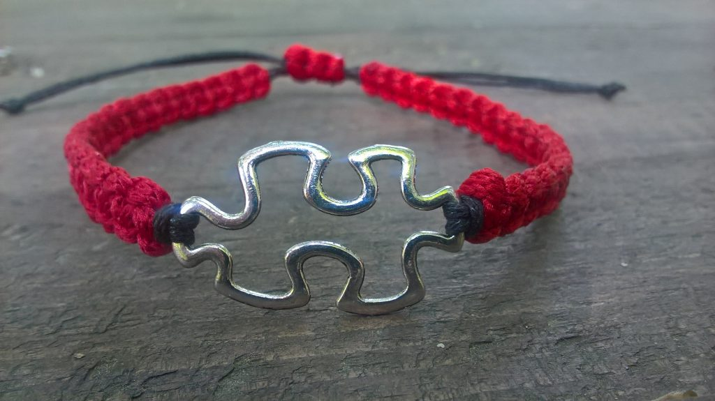 Handmade red-black puzzle friendship, macrame bracelet