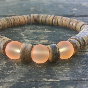 Handmade coconut bracelet with orange glass beads